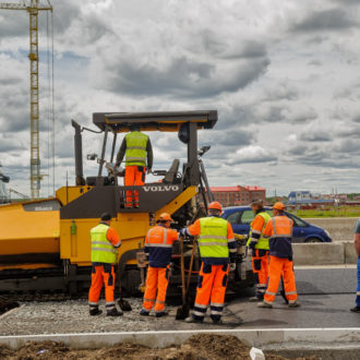 Tyumen Russia - June 1 2017: JSC Mostostroy-11. Construction of two-level outcome on bypass road on Fedyuninskogo and Permyakova streets intersection. Road rollers compressing sand to highway construction